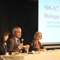 Yuka Iwatsuki (left), Stefano Scarpetta (center) and Deborah Greenfield speak during a panel discussion during the ACE SDG8.7 Dialogue Dinner in April in Tokyo. | RYUSEI TAKAHASHI