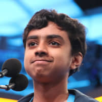 Ariya Narayanasamy smiles after correctly spelling 'pyrexia' during the second day of oral spelling at the Scripps National Spelling Bee. | KYODO