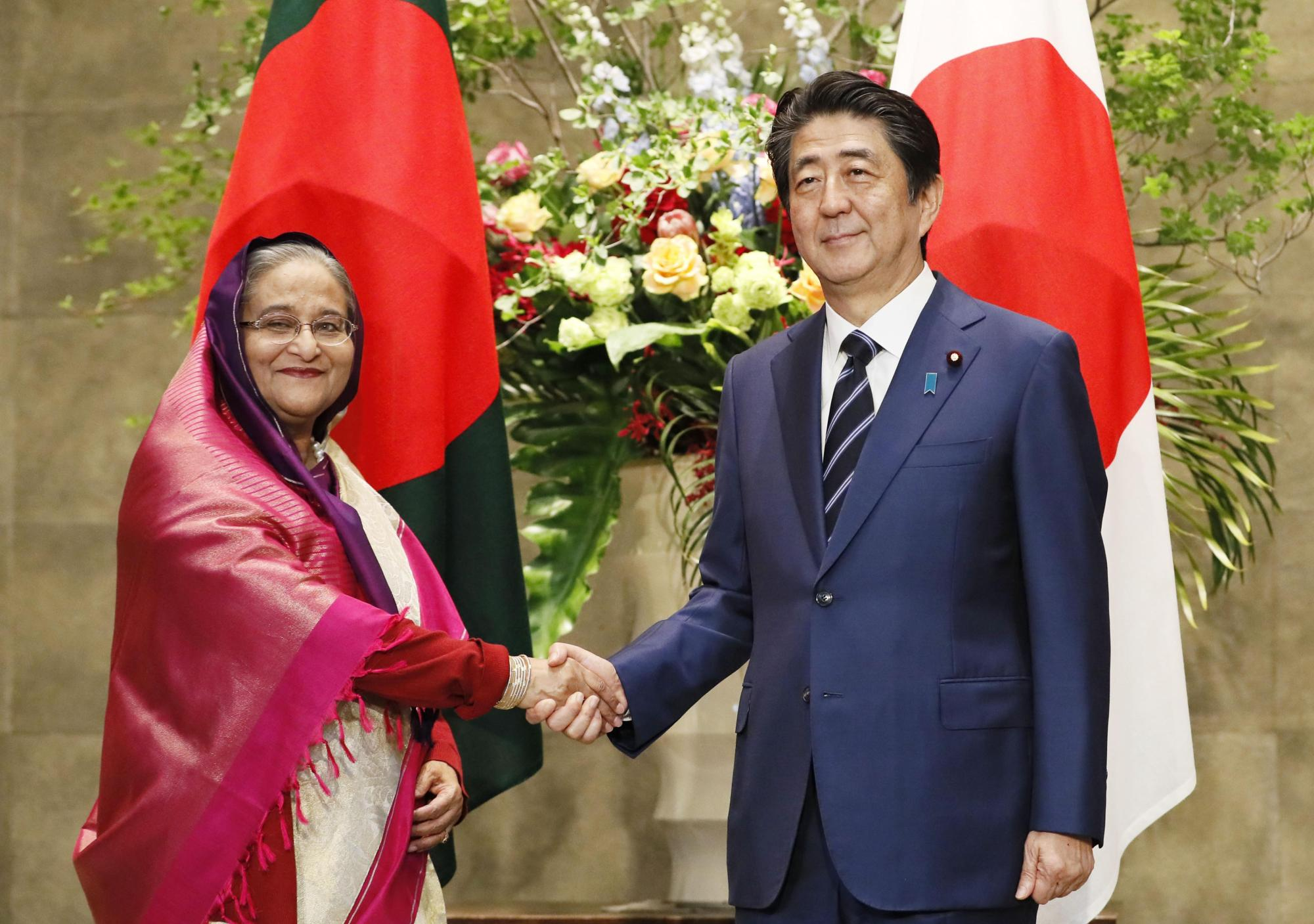 Prime Minister Shinzo Abe meets with his Bangladeshi counterpart, Sheikh Hasina, in Tokyo on Wednesday. | KYODO