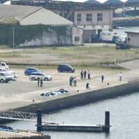 Four people were confirmed dead Monday after their bodies were discovered in a submerged car off a port in Kagoshima Prefecture. | KYODO
