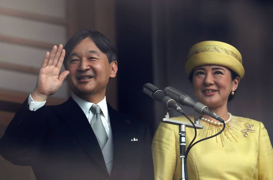 Emperor Naruhito and Empress Masako greet well-wishers during their first public appearance in their new roles at the Imperial Palace in Tokyo on Saturday.