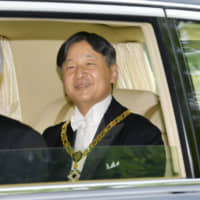 Emperor Naruhito is driven to the Imperial Palace in Tokyo on May 1, following his accession to the throne. | KYODO