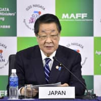 Farm minister Takamori Yoshikawa speaks during at a news conference Sunday in Niigata after a G20 ministerial meeting on agricultural issues. | KYODO