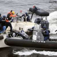 Police and coast guard anti-terror units conduct a drill last month in the city of Osaka ahead of the Group of 20 summit meeting to be held there next month. | KYODO