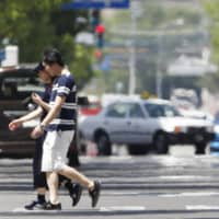 Two die and nearly 600 taken to hospitals as heat wave roasts much of Japan