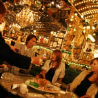 Female customers enjoy chatting and having drinks with male hosts at a Tokyo host club. | GETTY IMAGES / VIA KYODO