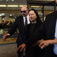 Huawei's chief financial officer, Meng Wanzhou, leaves the Supreme Court of British Columbia in Vancouver after a hearing May 8. | BLOOMBERG