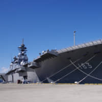 The helicopter carrier Izumo is docked at the Maritime Self-Defense Force base in Yokosuka, Kanagawa Prefecture, in March. | REIJI YOSHIDA