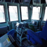 The Izumo is docked in Yokosuka, Kanagawa Prefecture, in March. The ship, whose air-traffic control cabin is pictured here, currently serves as a helicopter carrier, but there are plans to remodel the vessel so it can accommodate F-35B stealth fighters.