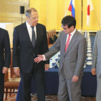 From left, Russian Defense Minister Sergey Shoigu, Russian Foreign Minister Sergey Lavrov, Japanese Foreign Minister Taro Kono and Japanese Defense Minister Takeshi Iwaya gather ahead of their 'two-plus-two' meeting in Tokyo on Thursday. | POOL / VIA KYODO