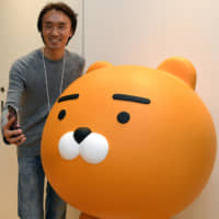 Jay Kim, head of Kakao Japan Corp., a subsidiary of South Korea's Kakao Corp. and operator of the popular manga app Piccoma, poses during an interview in Tokyo's Roppongi district last month. | YOSHIAKI MIURA