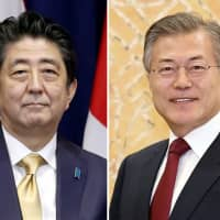 Prime Minister Shinzo Abe and South Korean President Moon Jae-in | KYODO