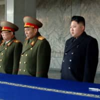 North Korean leader Kim Jong Un attends the mourning service for his father, late leader Kim Jong Il, in Pyongyang, in this handout photo taken on Dec. 29, 2011. | AFP-JIJI