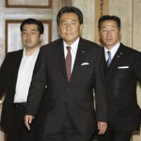 Yukio Edano (center), head of the Constitutional Democratic Party of Japan, prepares to meet with the leaders of other opposition parties at the Diet on Wednesday. | KYODO