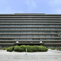 The Osaka High Court on Monday upheld a lower court ruling sentencing a man to 30 years in prison for murdering a man and injuring his three children at their home in Osaka Prefecture in 2016. | KYODO