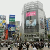 Tokyo's Shibuya scramble crossing was the site of a March prank in which a group placed a bed with a YouTuber on top in the middle of the intersection as pedestrians traversed it. | KYODO
