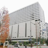 Based on the result of a psychiatric test, the Tokyo High Court on Monday scrapped a life prison term for a man and sentenced him to 25 years in prison for the murders of three family members and the attempted murder of another in 2016. | KYODO