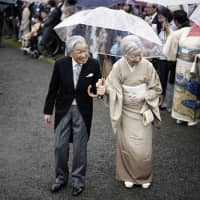 Emperor Akihito and Empress Michiko greet guests during the autumn garden party at the imperial garden within the Akasaka Estate in Tokyo in November. | AP