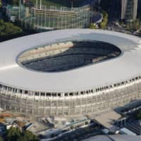 An aerial photo taken Friday shows the New National Stadium in Tokyo's Shinjuku Ward. | KYODO