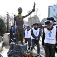 """A statue symbolizing Korean laborers forcibly taken to Japan during its colonial rule stands near the Japanese Consulate in Busan. 