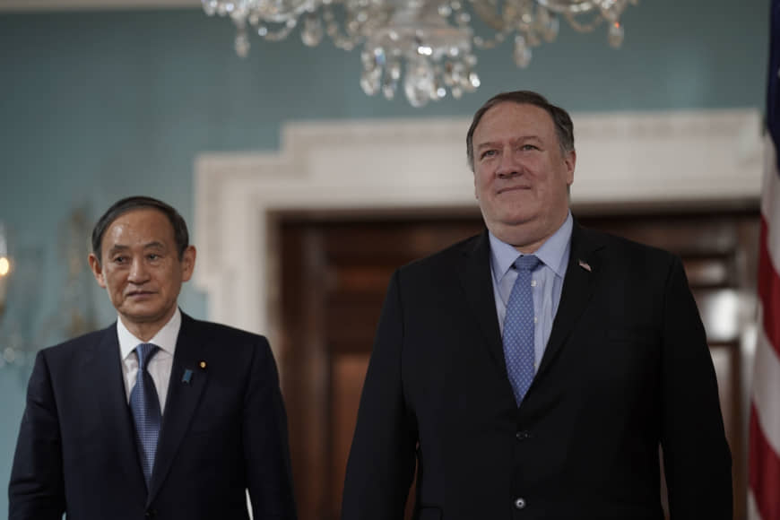 Chief Cabinet Secretary Yoshihide Suga arrives with U.S. State Secretary Mike Pompeo on May 9 at the State Department in Washington. | AP