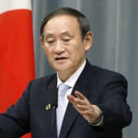 Chief Cabinet Secretary Yoshihide Suga speaks at a daily news briefing on Friday at the Prime Minister's Office, where he suggested a no-confidence motion against Abe's Cabinet could trigger a snap election. | KYODO