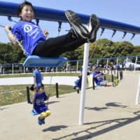 This photo, taken in Hibikinada Green Park in Kitakyushu on Saturday, shows a circular swing measuring about 163 meters in circumference. A total of 100 swings are attached to the structure. It has been recognized by Guinness World Records as the world's biggest. | KYODO
