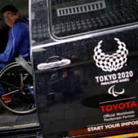 Toyota's committee-designed Japan Taxi becomes pricey symbol of Olympic budget-busting