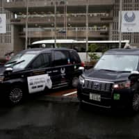 Toyota's Japan Taxi cars are parked in Tokyo on March 4. | REUTERS