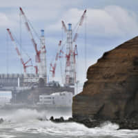 The Fukushima No. 1 nuclear power plant is seen on March 11 in Futaba, Fukushima Prefecture. The complex was struck by the 2011 earthquake-tsunami disaster and is currently being decommissioned. | KYODO