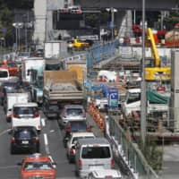 A traffic jam in central Tokyo last July | KYODO