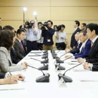 A meeting is held at the Prime Minister's Office in Tokyo on Friday to discuss measures to tackle human trafficking in Japan. | KYODO