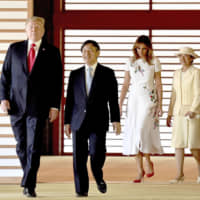U.S. President Donald Trump and Emperor Naruhito share smiles as first lady Melania Trump and Empress Masako walk behind during the American presidential couple's state call at the Imperial Palace in Tokyo on Monday.   pool / via kyodo