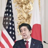 Prime Minister Shinzo Abe speaks during a joint news conference in Tokyo on Monday.   POOL / VIA KYODO