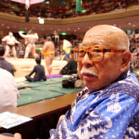 Kenzo Furushima, an 83-year-old sumo enthusiast, talks Friday about his concerns regarding U.S. President Donald Trump's upcoming visit to the Summer Grand Sumo Tournament in Tokyo.   CHISATO TANAKA
