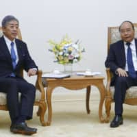 Vietnamese Prime Minister Nguyen Xuan Phuc, right, and Defense Minister Takeshi Iwaya hold talks in Hanoi on Saturday. | KYODO