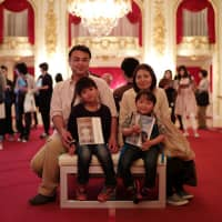 The Shimizu family poses for a photo Wednesday inside the State Guest House Akasaka Palace in Tokyo. | RYUSEI TAKAHASHI