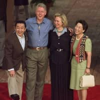 Prime Minister Ryutaro Hashimoto shows off his cowboy boots as he poses with U.S. President Bill Clinton, first lady Hillary Clinton and his wife, Kumiko, during a state visit in 1997. | AP