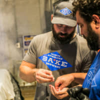 Brewing up something new: Co-owners Andrew Centofante (left) and Jeremy Goldstein examine rice at their brewery. | JOHN ROBINSON PHOTOGRAPHY