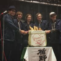 Getting the party started: (From left) Masashi Togami breaks open a ceremonial sake cask with Phoenix band members Thomas Mars, Deck d'Arcy, Christian Mazzalai and Laurent Brancowitz. | MELINDA JOE