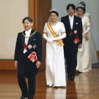 Crowning glory: Emperor Naruhito, Empress Masako, Crown Prince Fumihito and Crown Princess Kiko attend an enthronement ceremony in Tokyo on May 1. | KYODO