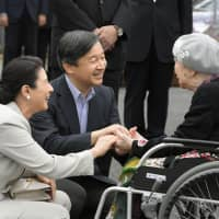 Then-Crown Prince Naruhito and then-Crown Princess Masako visit a temporary housing shelter on Sept. 26 in Asakura, Fukuoka Prefecture, after torrential rains hit the area in July 2017. | KYODO