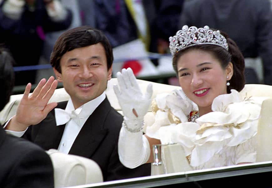 Then-Crown Prince Naruhito and then-Crown Princess Masako wave during their wedding parade on June 9, 1993.