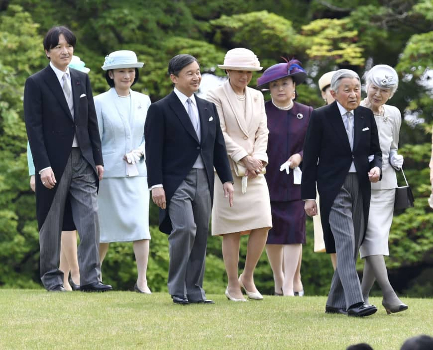 Members of the imperial family walk together at an imperial garden party in April 2018.