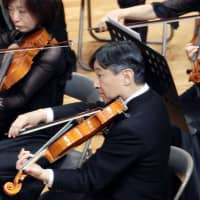 Then-Crown Prince Naruhito plays viola at a concert in an orchestra of Gakushuin University graduates in Tokyo on Dec . 9, 2018. | KYODO