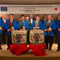 European Union Ambassador Patricia Flor (third from right) and Japanese dignitaries break open sake barrels at a ceremony marking the entry into force of the EU-Japan economic partnership agreement on Feb. 1. | YASUHIKO SHIMAZU, EUROPEAN UNION