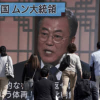 A TV news show featuring South Korean President Moon Jae-in is broadcast in Tokyo on May 10. To improve bilateral relations, Japan and South Korea have to take advantage of open doors to cooperation and the U.S. must continue opening some of those doors for them. | AP