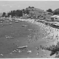 Life's a beach: A snapshot of Shiraishi Island's beach during the mid-1950s before the construction of a road between the shore and the residences. | COURTESY OF THE SHIRAISHI ISLAND ARCHIVES