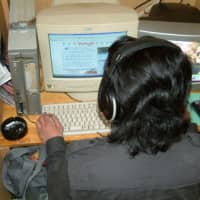 Old school: The typical workspace at an internet cafe in the early 2000s resembled a cubicle at an office.   KYODO