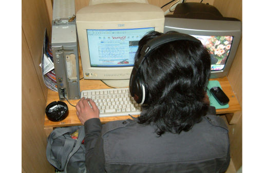 Old school: The typical workspace at an internet cafe in the early 2000s resembled a cubicle at an office.